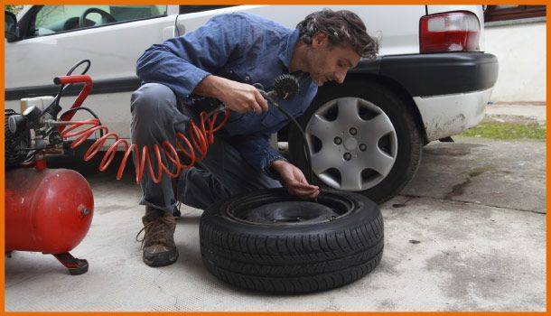 Man filling up tire with air